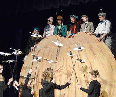 From left, Jane Palagi plays Spider, Nicholas McCann portrays Earthworm, Andy O'Daniel is Grasshopper, Shelby Hayden is Ladybird, Ally Howard is James and Alexis Hayden plays Centipede as they ride atop a giant peach while being attacked by seagulls.