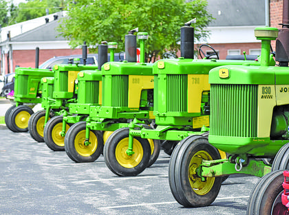 A row of John Deere tractors sit Thursday behind the Taylor County Courthouse.