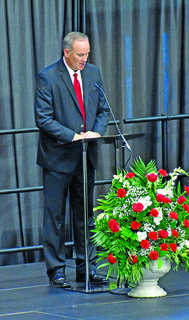 Taylor County High School Principal Jon Hall addresses the Class of 2019 in Friday's graduation ceremony at Citizens Bank Arena.