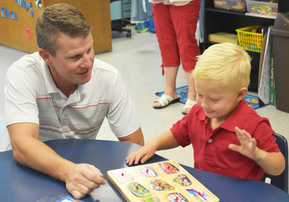 Asher Hines, 3, gets prepared for his first day of school at Kentucky Christian Academy with his father, Jared Hines.