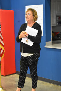New KCA Administrator Lori Riggs addresses students at an assembly before classes begin.
