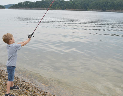 Josiah Castiner, 6, of Campbellsville, casts his line far from the shore.