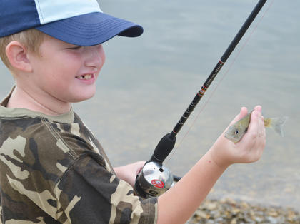 Brandon Estes, 8, of Lebanon, caught the first fish of the day on Saturday.