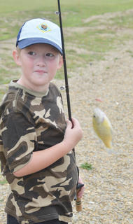 Brandon Estes, 8, of Lebanon, came to Green River Lake on Saturday to participate in his first fishing derby. He caught the first fish of the day.
