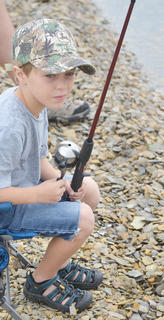 Josiah Castiner, 6, of Campbellsville, waits to see if the fish are biting.