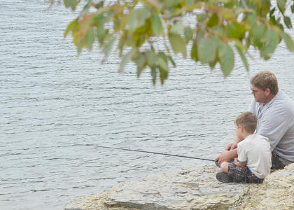 They placed the bait on the hook and waited. Some didn't have to wait long. Others weren't so lucky. U.S. Army Corps of Engineers hosted the annual Kids' Fishing Derby on Saturday. More than 40 children and adults participated. Above, Chase Whitley, 5, and his dad, Charles, of Campbellsville, wait to see if the fish are biting.
