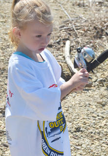Ciara Shreve, 3, of Campbellsville, reels in her fishing line.