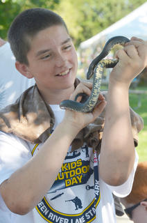 Johnny Rapier, 13, of Greensburg, holds a snake that was found near Green River Lake.