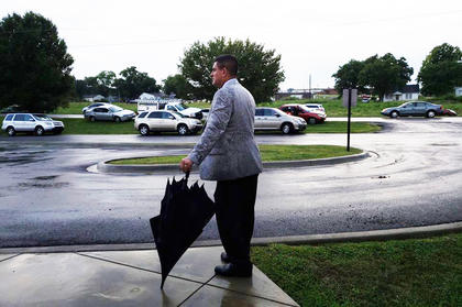 Campbellsville Independent Schools Superintendent Kirby Smith awaits students as they arrive at Campbellsville Elementary School.