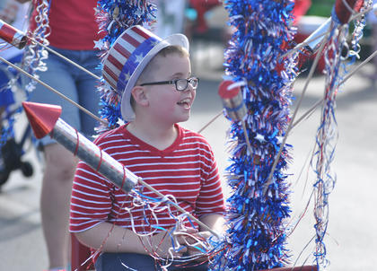 A boy is all smiles as he participates in Tuesday's children's parade sponsored by the Taylor County Public Library.