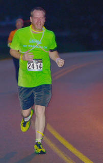 Mark Sanford dresses the part to make sure he glows as he finishes the race.