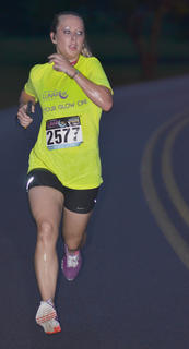 Melanie Wood gets her stride as she finishes the race.