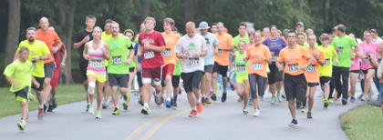 """Runners take off as they hear the word """"Go."""""""
