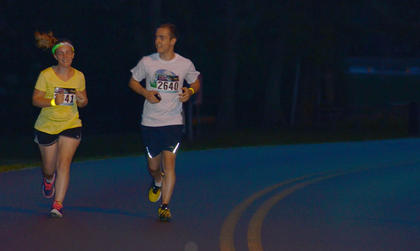 Kellyn Pufal, at left, and Jonathan Pufal run together to finish the race.