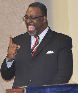 """Guest speaker the Rev. Bernard Crayton tells the audience that Dr. Martin Luther King Jr. is a man he has admired his whole life. Pastor of Little Flock Missionary Baptist Church in Louisville, Crayton said """"to know where you come from, you gotta know your history."""""""