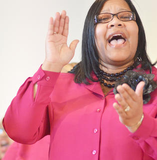 Renee Price sings with Bethel AME Church Choir at this year's MLK worship service. The community's Ecumenical Ministerial Alliance hosted the service.