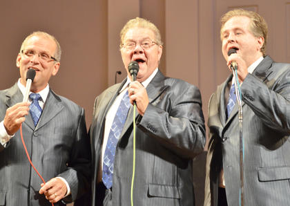 From left, Kenny Roberts, Garry Polston and Tracy Bertram, members of The Noblemen, perform on Sunday.