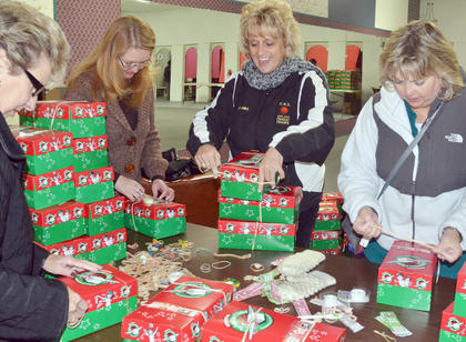 Taylor County's Operation Christmas Child relay station, organized by Campbellsville University, will remain open through Monday, Nov. 24. The center will be open Thursday from 5:30 to 6:30 p.m., Friday from 11 a.m. to 1 p.m., Saturday from noon to 1 p.m., Sunday from 1 to 3 p.m. and Monday from 9 to 11 a.m. On Monday, 2,090 boxes were collected. As of Wednesday morning, the total stood at 2,939. For more information, call (270) 789-5029. Above, volunteers sort through OCC shoeboxes.