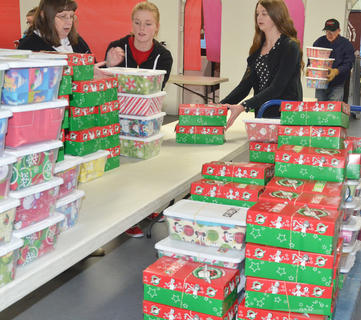 Volunteers sort through OCC shoeboxes.