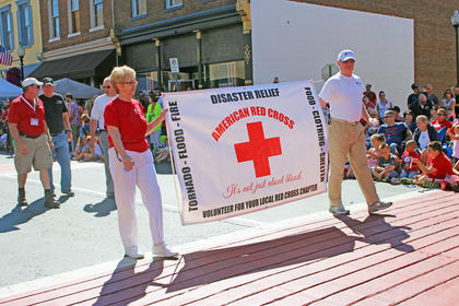 Taylor County's American Red Cross disaster relief team displays their banner while walking in the parade.