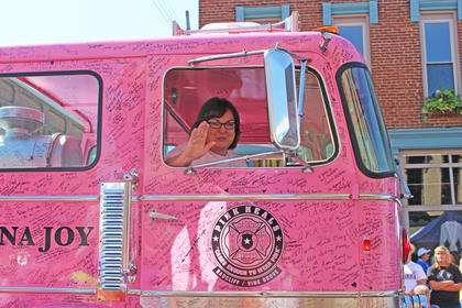 Guardians of The Ribbon, operated by Radliff/Vine Grove Fire Department drive a pink fire truck through the parade to support breast cancer awareness.