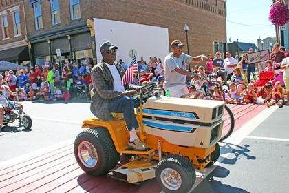 Lawn mowers and bicycles were popular mode of transportation in this year's parade.