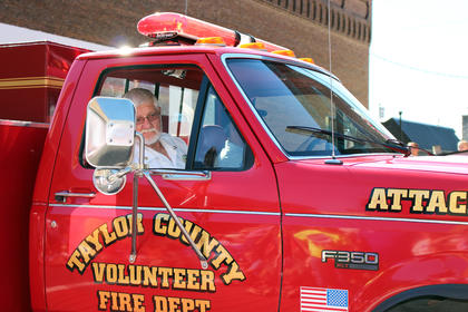 Taylor County Fire & Rescue Chief George Wilson rides in a fire truck through the parade.