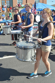 Campbellsville and Taylor County high school marching bands combined to perform at the Fourth of July parade on Friday morning.