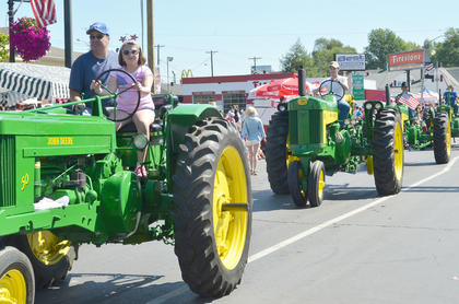 Tractors were a featured part of the Fourth of July parade on Friday morning.