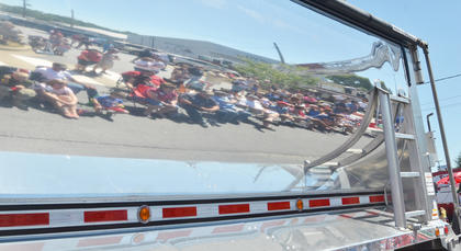 Spectators can see their reflection in this truck as it heads down Main Street during the Fourth of July parade on Friday morning.