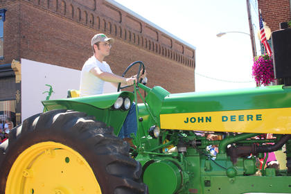 Residents rode atop tractors during the parade.