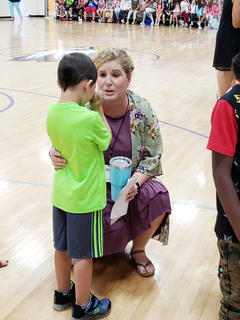 Campbellsville Elementary School first grade teacher Rebecca Lawless consoles one of her students.