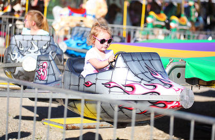 Cora Moss, 2, of Bardstown, enjoyed a ride at the Taylor County Fair while visiting family in Campbellsville Tuesday.