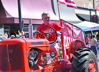 Ryan Quarles, the Kentucky Agriculture Commissioner, rides an Allis-Chalmers tractor in the parade Thursday.