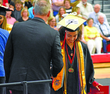Taylor County graduate Shay Mitchell is all smiles after she walks across the stage during Friday's graduation at Citizens Bank Arena.