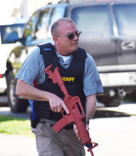 Bobby Gribbins from the Taylor County Sheriff's Office prepares to enter the building during a recent active shooter drill at CU.