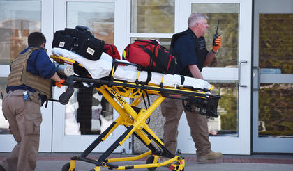 EMS personnel prepare to enter the scene during an active shooter drill last Friday