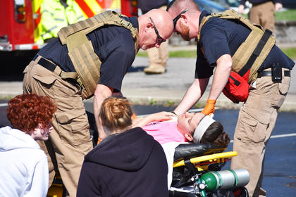 EMS personnel tend to students portraying shooting victims during a recent drill at Campbellsville University