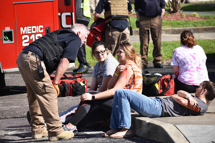 EMS personnel check on students during a recent active shooter drill. Students were given fake wounds to add to the authenticity of the drill.