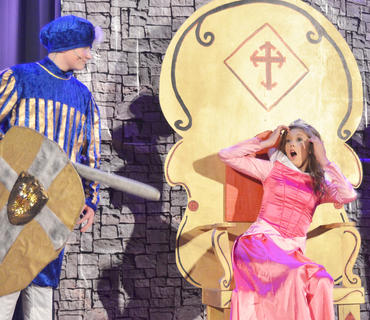 Callie Botkin portrays Sleeping Beauty, at right, and is surprised to find her love, Prince Phillip, portrayed by Matthew Magness, has come to rescue her.