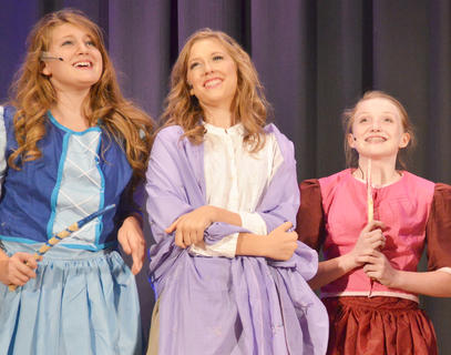 """Callie Botkin portrays Briar Rose, center, who smiles as she tells her """"aunts,"""" from left, Merryweather, played by Emma Humphress, and Fauna, portrayed by Natalie Reynolds, that she has fallen in love. The """"aunts"""" are really fairies."""