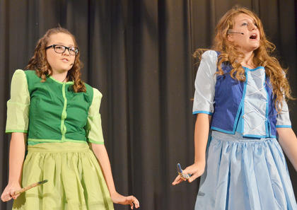 Flora, played by Hailey Morris, at left, and Merryweather, played by Emma Humphress, sing about finally being able to use fairy magic again, as Briar Rose has turned 16 and can finally be told she is really Sleeping Beauty.