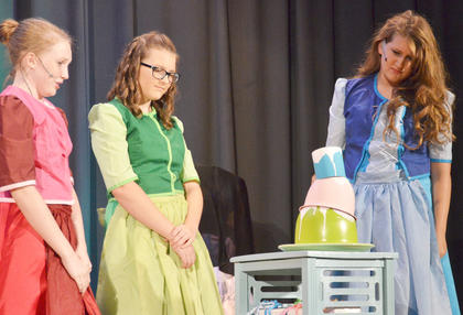 """Sleeping Beauty's """"aunts,"""" from left, Natalie Reynolds as Fauna, Hailey Morris as Flora and Emma Humphress as Merryweather, realize that they aren't very good cooks without their magic. The """"aunts"""" are really fairies."""