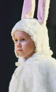 Claire Goff portrays a bunny.