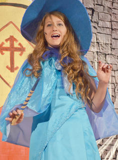 Emma Humphress as Merryweather, a fairy, sings about her magic.