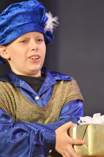 Dawson Propes portrays a young Prince Phillip, who doesn't understand why he must give a gift to a baby. That baby, however, would grow up to be his love, Sleeping Beauty.