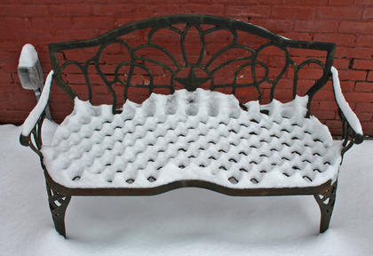 Benches in the alley off of Main Street were covered in snow.