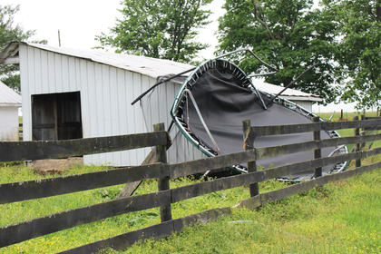 This crumpled trampoline was carried several feet and snapped a power line before crashing into a shed on Chad Sullivan's farm on Saloma Road.