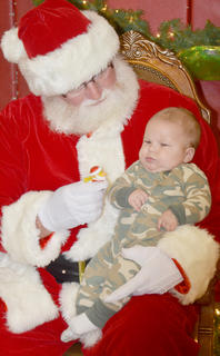 Luke Grisso, 3 months, sits in Santa's lap for the first time.