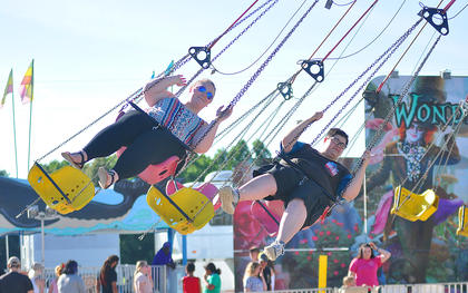 Fairgoers ride the Swings on Wednesday.